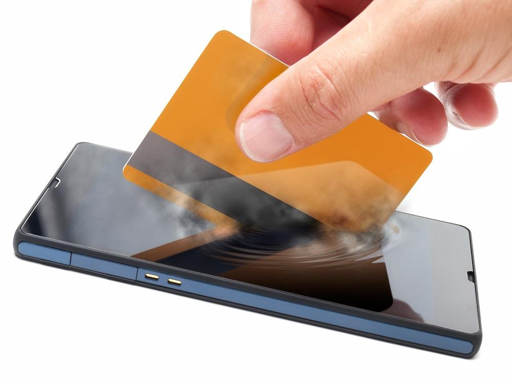 mobile_payment_transaction_e-commerce_shop_online_shutterstock_154844699