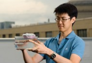 MIT graduate student George Ni holds a bubble-wrapped, sponge-like device that soaks up natural sunlight and heats water to boiling temperatures, generating steam through its pores.  Photo: Jeremy Cho