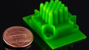 A new microencapsulation technique yields particles of very consistent size, while also affording a high rate of production. The device, pictured here, used to produce the spheres were themselves manufactured with an affordable commercial 3-D printer. The ability to 3-D print fabrication systems would not only keep manufacturing costs low but also allow researchers to quickly develop systems for producing microencapsulated particles for particular applications.  Courtesy of the researchers